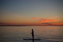 Красивые заход солнца и прибой Стоковое фото RF