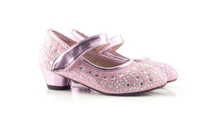 Красивые и яркие розовые ботинки девушки на белизне Стоковое фото RF