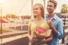 Красивые молодые пары на дате смотря прочь Стоковая Фотография RF