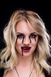 Красивый белокурый вампир девушки Стоковое фото RF