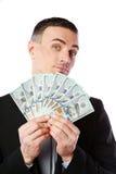 Красивый бизнесмен держа доллары США Стоковая Фотография RF