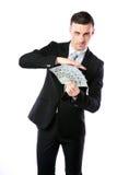 Красивый бизнесмен держа доллары США Стоковая Фотография