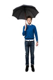 Красивый бизнесмен стоя под зонтиком Стоковые Изображения RF