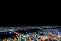 Красивый воздушный взгляд ночи городского пейзажа Осака, Японии Стоковое Фото