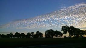 Красивый восход солнца с малыми облаками Стоковая Фотография RF