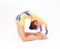 Красивый гибкий гимнаст девушки Стоковые Изображения