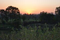 Красивый заход солнца на вечере Стоковые Изображения