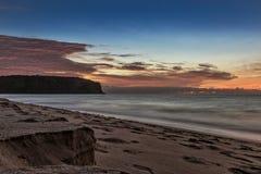 Красивый заход солнца на пляже Cabo Ledo anisette вышесказанного стоковая фотография