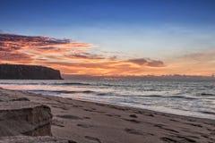Красивый заход солнца на пляже Cabo Ledo anisette вышесказанного стоковые изображения