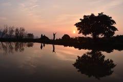 Красивый заход солнца озером с отражением Стоковое фото RF