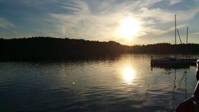 Красивый заход солнца над озером Стоковые Фото