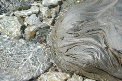 Красивый камень в воде моря Стоковые Фото