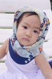 Красивый маленький ребёнок представляя для ее фотографии Стоковое Фото