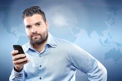 Красивый молодой человек с франтовским телефоном Стоковое Фото
