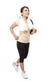 Красивый молодой азиатский jogging женщины крытый, изолированный стоковое фото rf