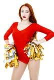 Красивый молодой рыжеволосый чирлидер в красной форме стоковое фото rf