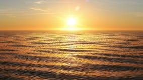 Красивый оранжевый заход солнца на океане закрепил петлей анимация 3d Светить Солнця яркий с пирофакелами 4K UHD 3840x2160 акции видеоматериалы
