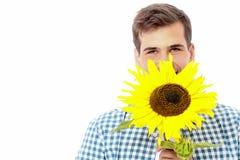 Красивый парень при солнцецвет изолированный на белой предпосылке День матери Валентайн лето seashells песка рамки принципиальной Стоковое Фото