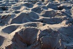 Красивый песок в лучах захода солнца Стоковая Фотография