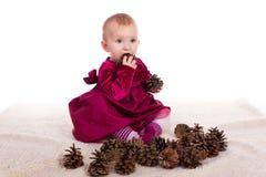 Красивый ребёнок в красном платье в Новогодней ночи Стоковое фото RF
