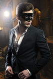 Красивый человек в маске стоковое фото rf
