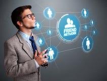 Красивый человек смотря современную социальную сеть Стоковые Фотографии RF