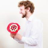 Красивый человек с цветками пука конфеты Стоковая Фотография RF