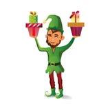 Красивый эльф с бородой держит 2 подарка для рождества Стоковое фото RF