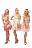 3 красивых девушки в изолированных платьях моды Стоковая Фотография RF