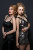2 красивых девушки в платьях вечера Стоковая Фотография