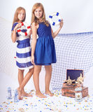 2 красивых предназначенных для подростков девушки стоя с lifebuoys Стоковые Изображения