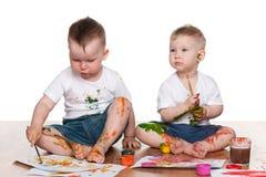Красить 2 мальчиков стоковые фото