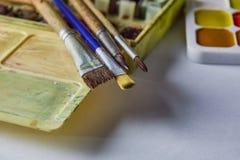 Краска акварели на таблице стоковая фотография rf