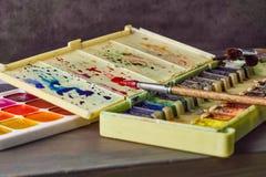 Краска акварели на таблице стоковые фотографии rf