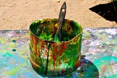 Краска может на таблице искусства Стоковое Фото