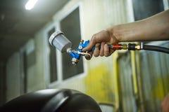 Краска с оружием брызга Стоковые Фото