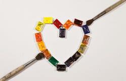 Краски акварели как heartshape с щетками Стоковые Фотографии RF