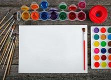 Краски акварели установили с щетками и бумажным листом Стоковые Фото