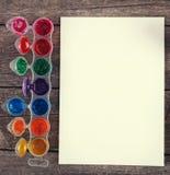 Краски акварели установили с щетками и бумажным листом Стоковое Изображение
