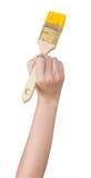 Краски руки Housepainter с щеткой в желтом цвете Стоковые Фотографии RF