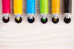 Краски цвета водные на деревянной поверхности Стоковая Фотография RF