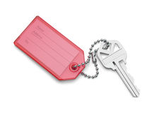 Красная бирка и ключ стоковые фото