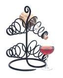 Красная бутылка вина гранатового дерева, соломы вина и держатель бутылки вина утюга Стоковые Изображения