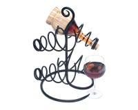 Красная бутылка вина гранатового дерева, соломы вина и держатель бутылки вина утюга Стоковые Фото