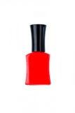 Красная бутылка маникюра на белой предпосылке Стоковая Фотография