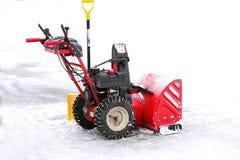 Красная воздуходувка снега стоковая фотография