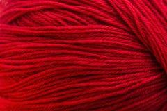 Красная вязать текстура потока, фон дела рук Стоковое фото RF