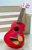 Красная гитара гавайской гитары Стоковое фото RF