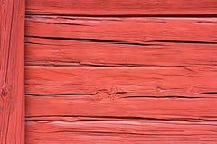 Красная деревенская текстура старой стены сельского дома Стоковое Изображение