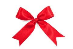 Красная лента смычка подарка сатинировки изолированная на белизне Стоковая Фотография